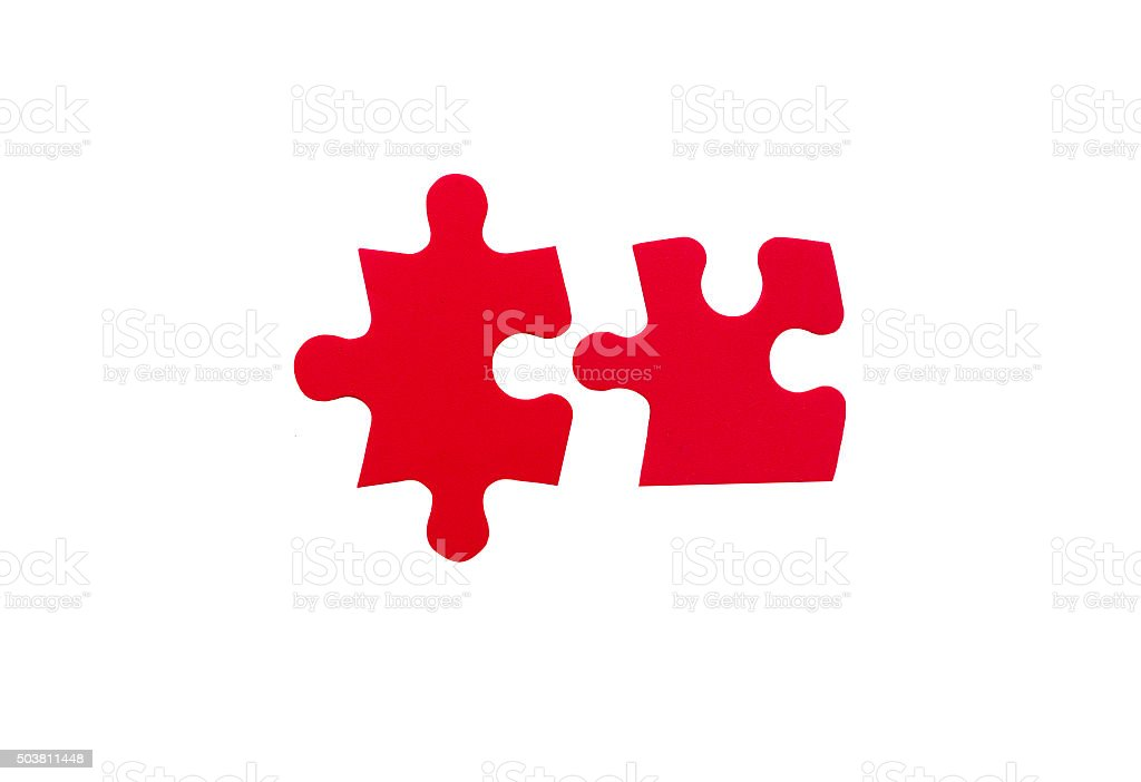 two red jigsaw pieces stock photo