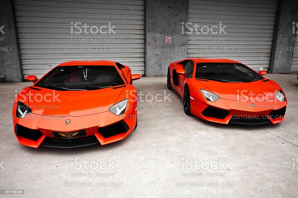 two red lamborghini aventador stock photo