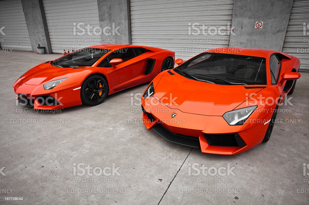 two red lamborghini aventador stock photo