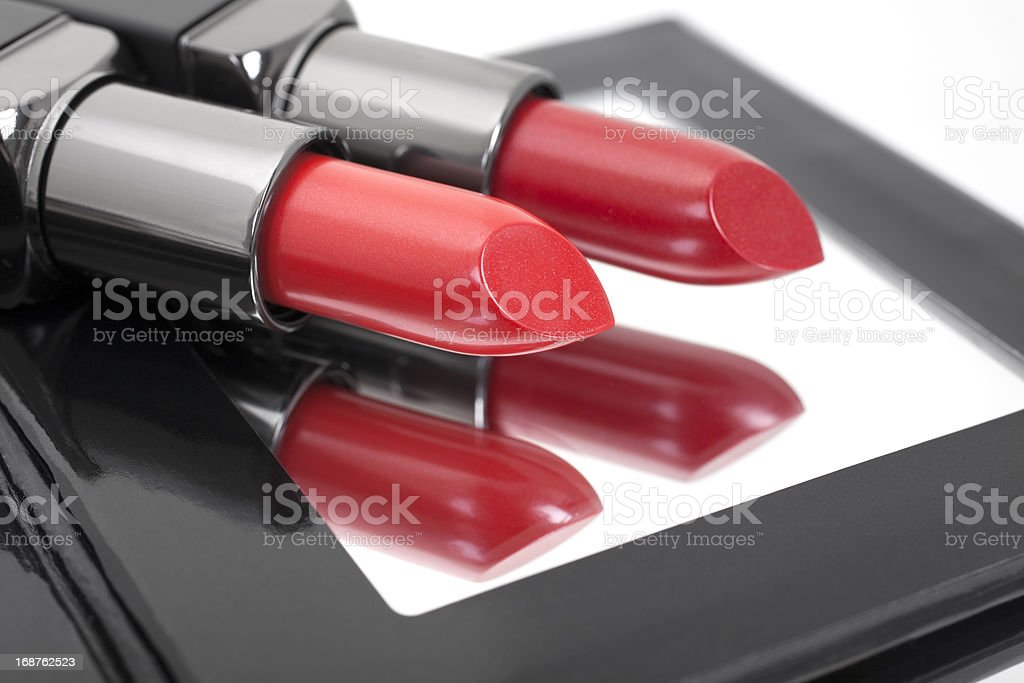 Two Red Lipstick Shades on Compact Mirror stock photo