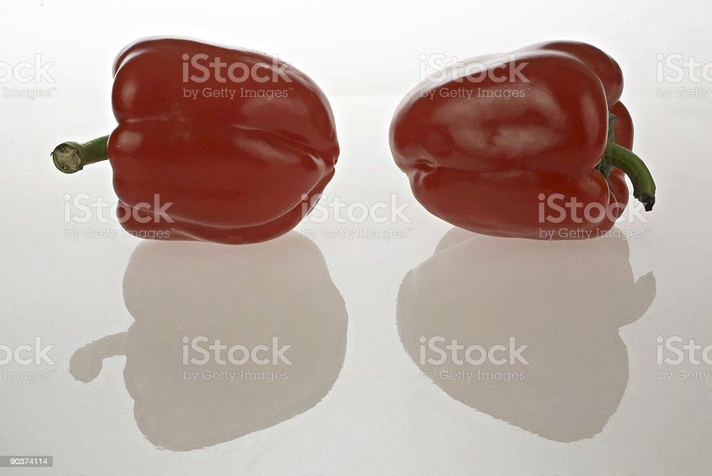 Two red peppers with reflections royalty-free stock photo