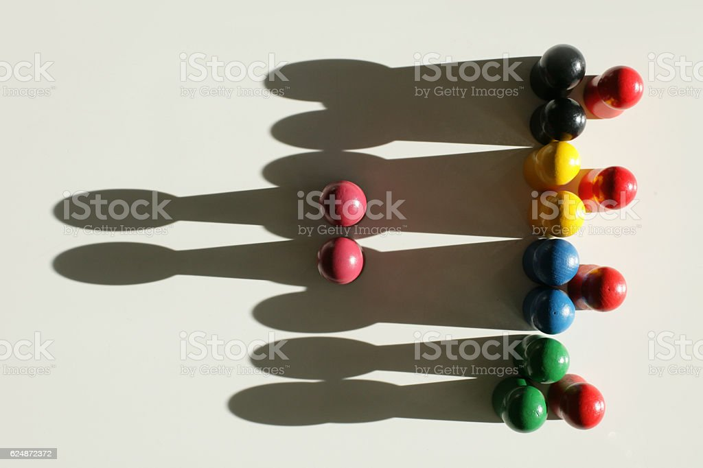 Two red pieces in front of a group stock photo