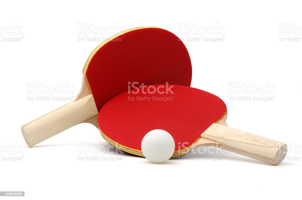 Two red ping-pong paddles and white ball on white ground stock photo