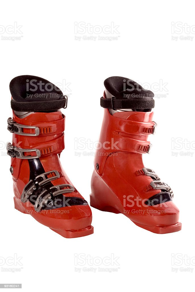 Two red snow ski boots on an isolated white background stock photo