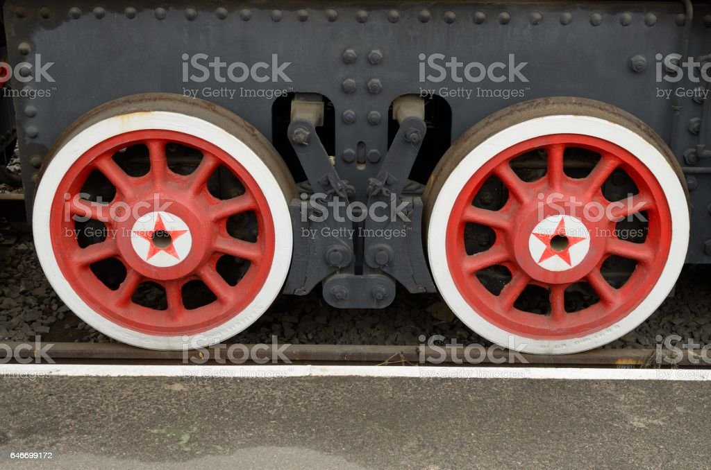 Two red wagon wheels. stock photo