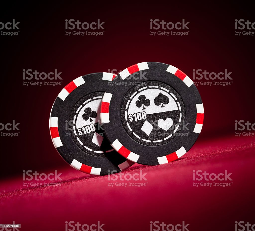 Two red white and black poker chips royalty-free stock photo