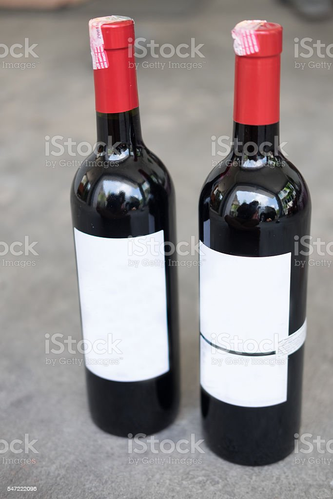 Two red wine bottle stock photo