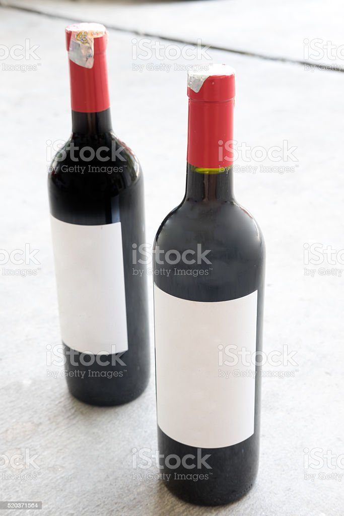 Two red wine bottle, with real paper blank label stock photo