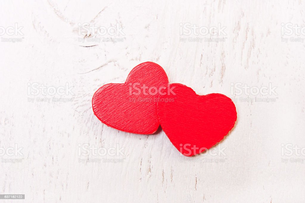 two red wooden heart on a white background stock photo