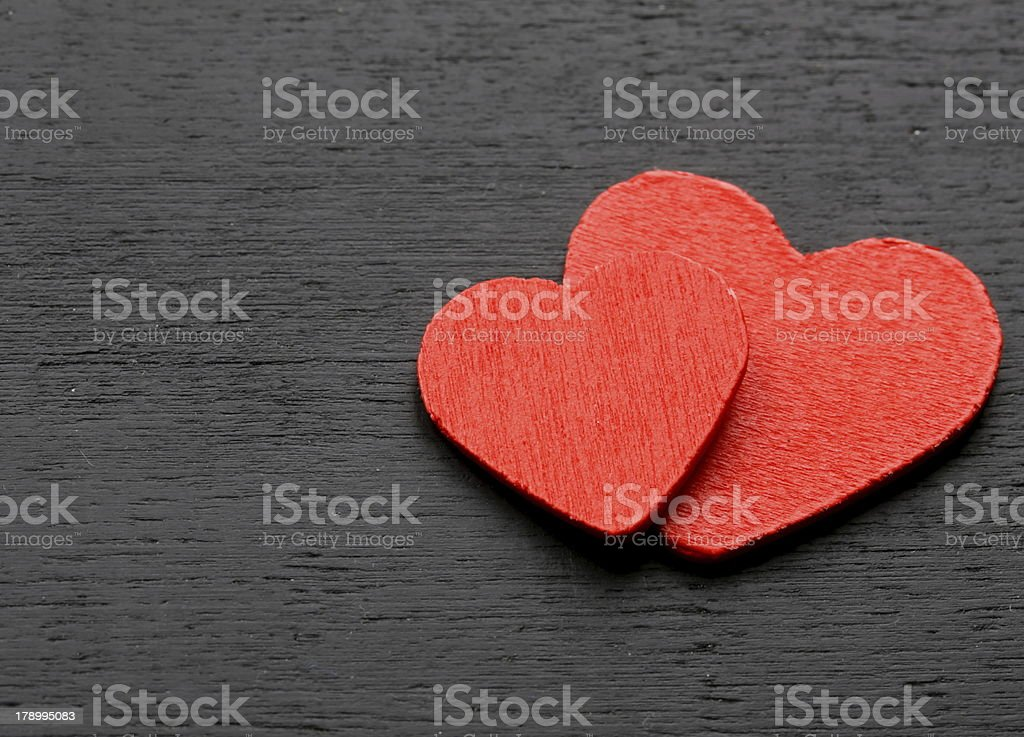 two red wooden hearts - symbol of love royalty-free stock photo