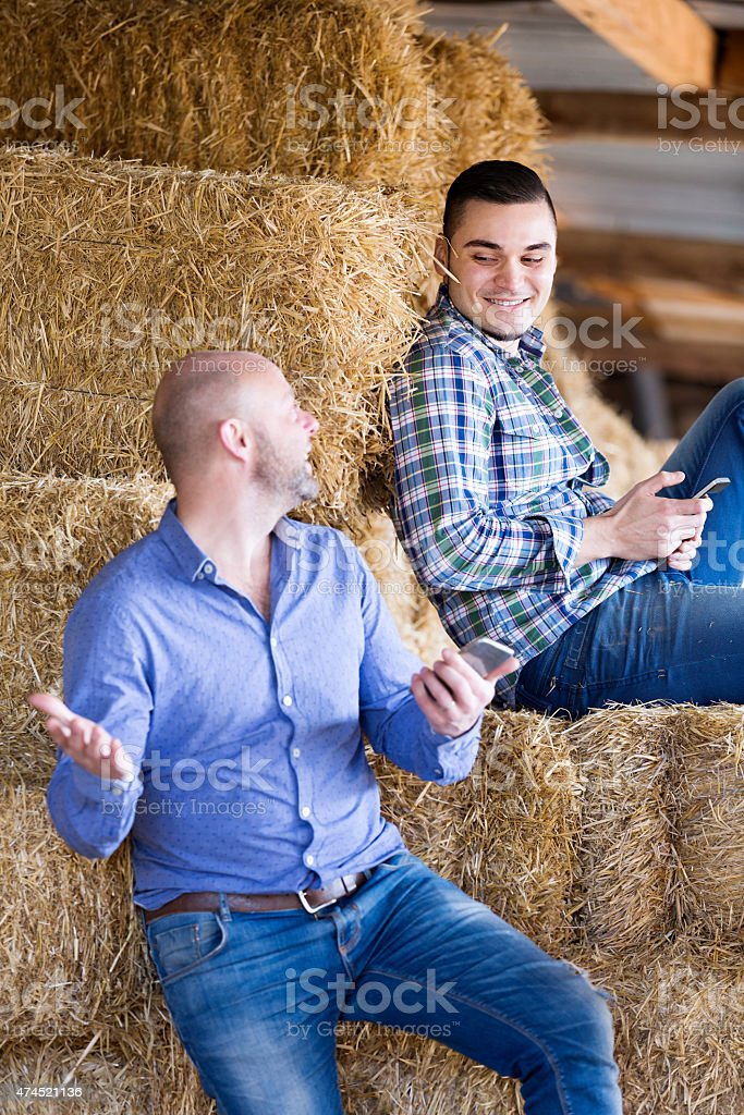 Two relaxed farm workers stock photo