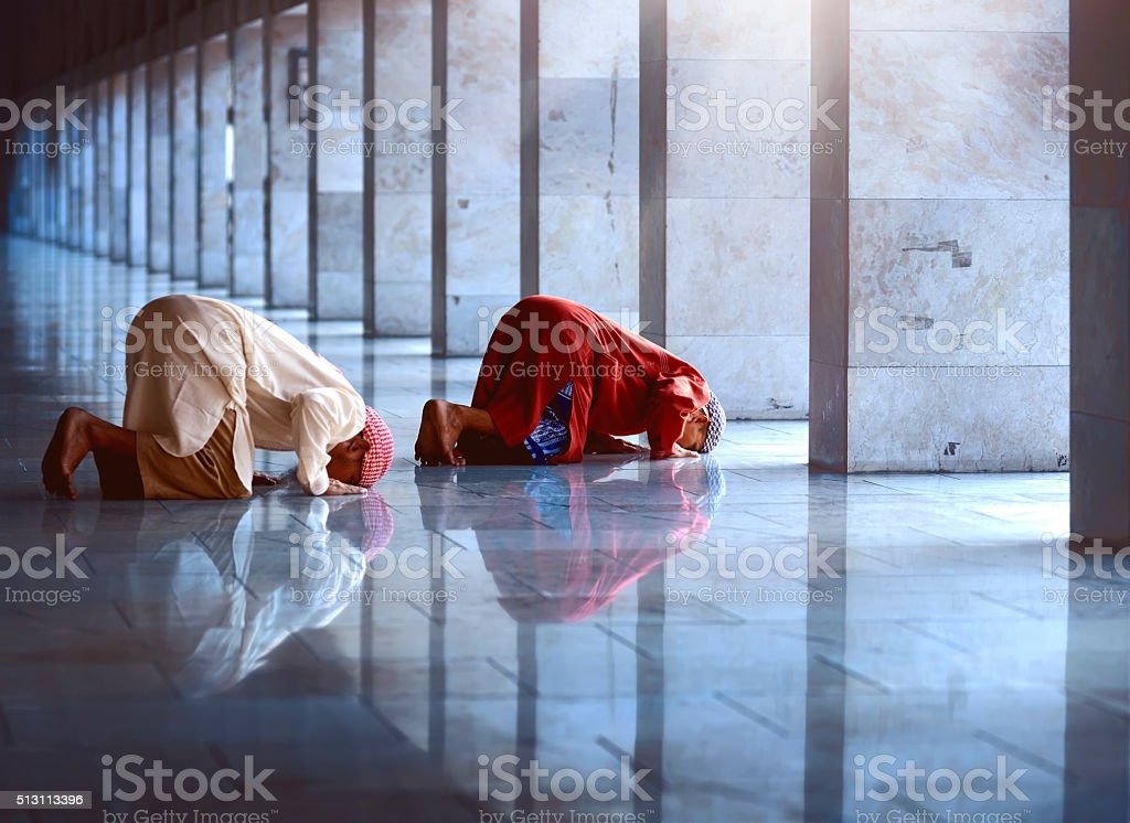 Two religious muslim man praying together stock photo