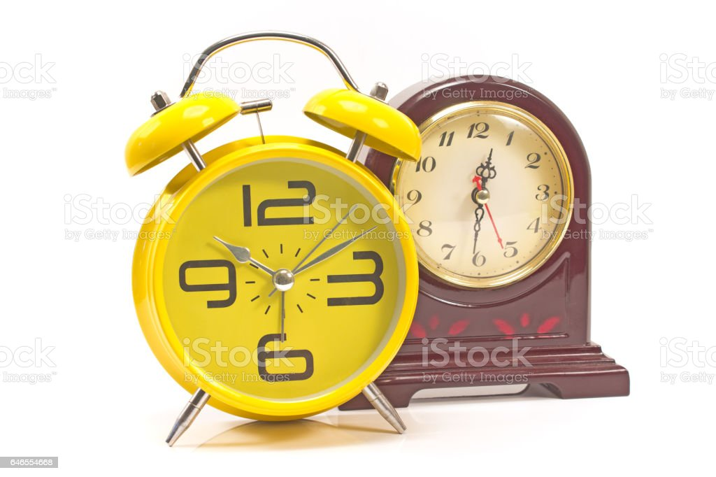Two retro style alarm clocks isolated on white stock photo