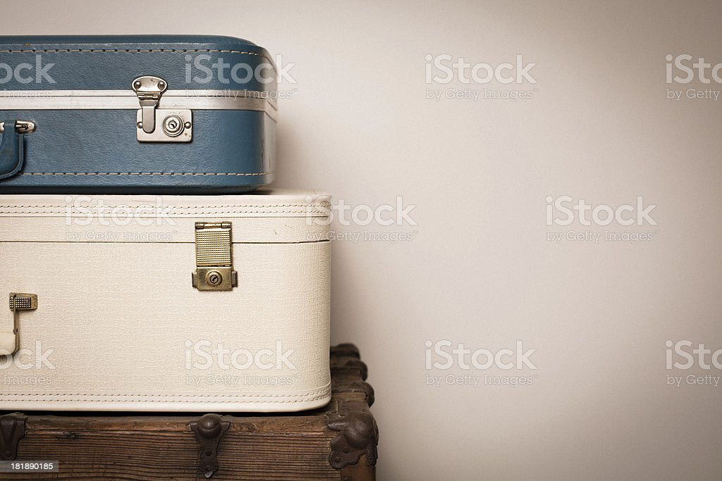 Two Retro Suitcases Stacked on Wood Trunk, With Copy Space royalty-free stock photo