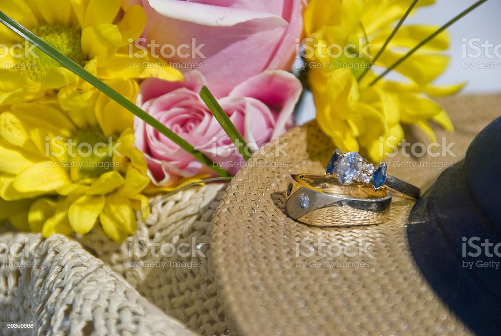 Two Rings on Hat with Flowers royalty-free stock photo