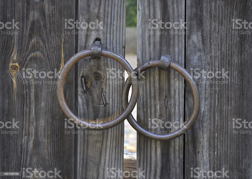 Two rings on old wooden gate royalty-free stock photo