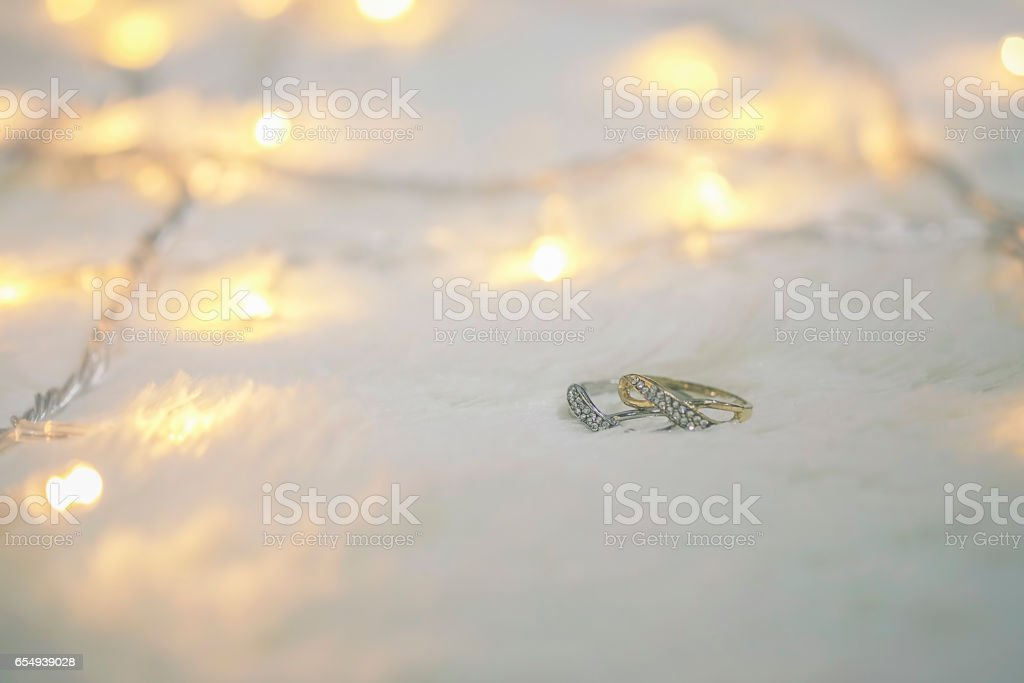 Two rings on wool Background.Soft focus,low light.(selective focus). stock photo