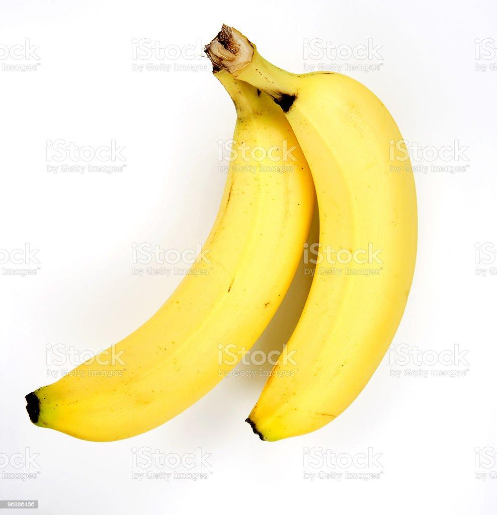 Two ripe yellow bananas on a white background stock photo