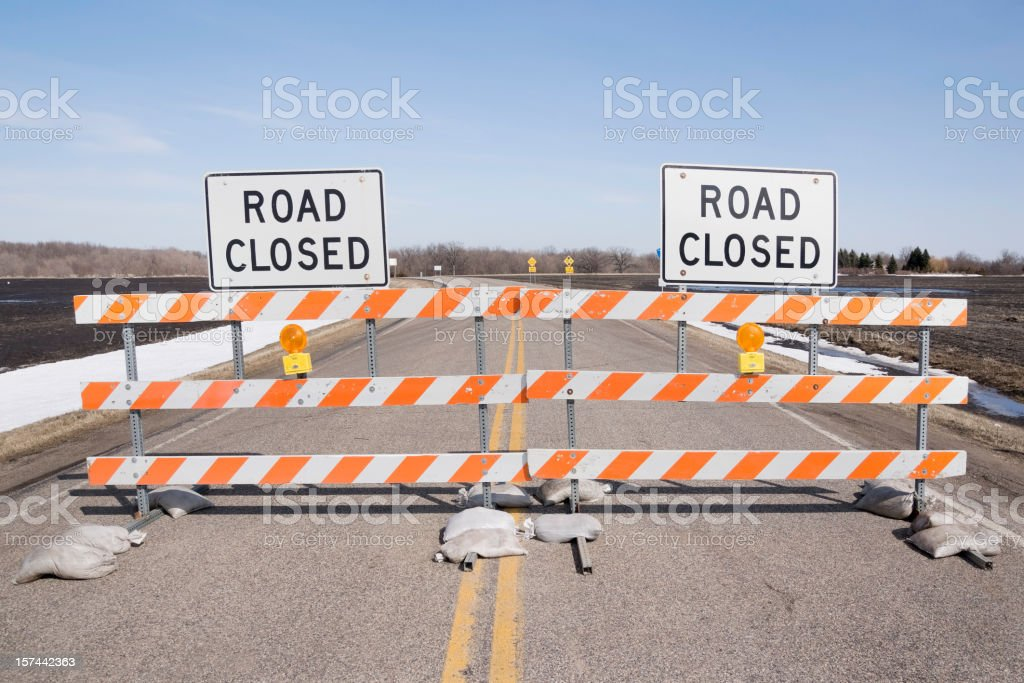 two road closed signs stock photo