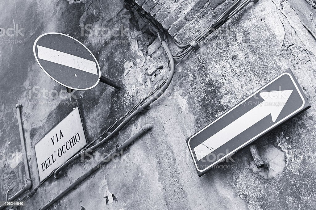 Two road signs in an old Italian alley stock photo