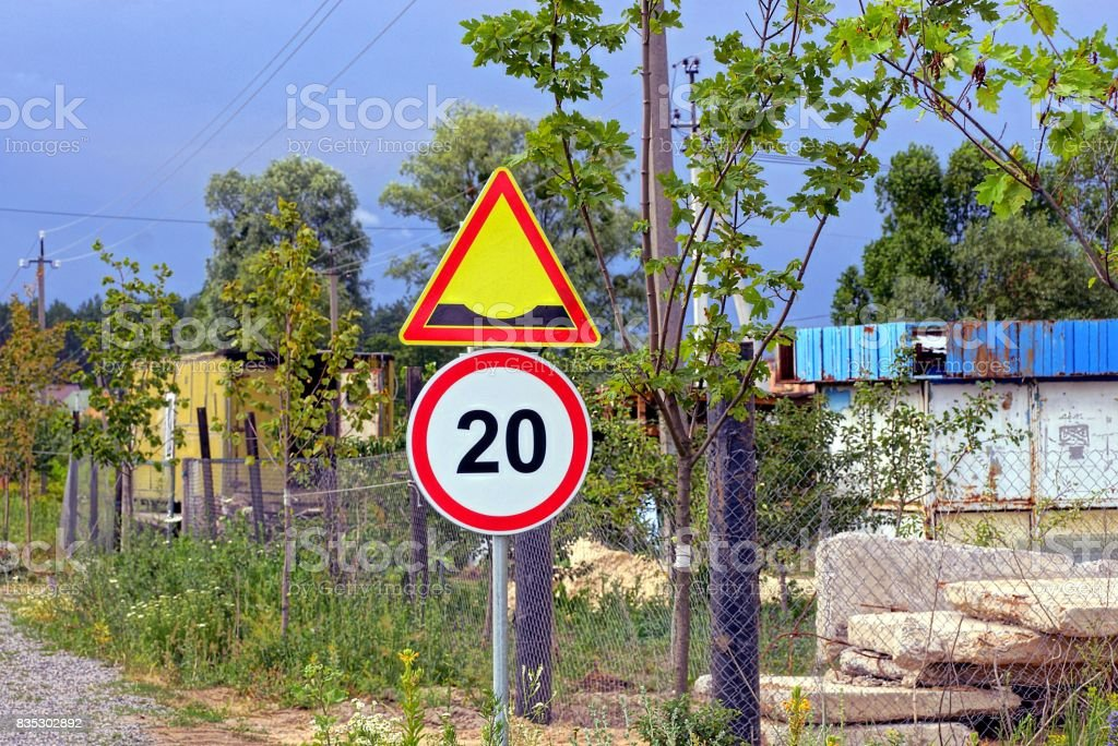 Two road signs on a street in a summer sunny day stock photo