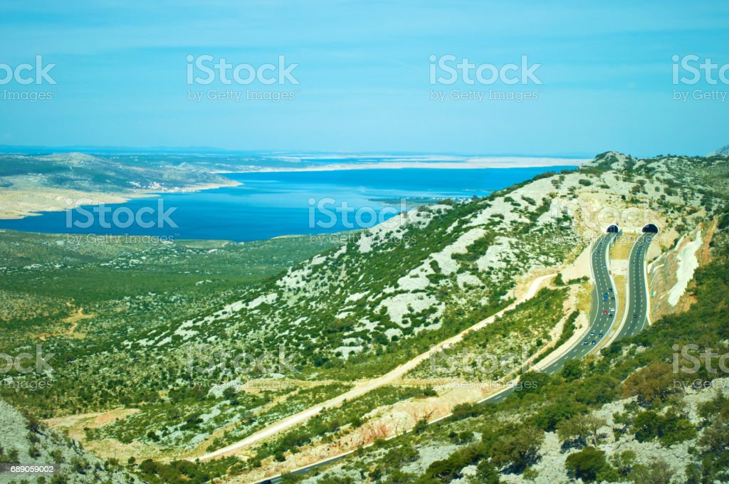 Two roads on a highway leading to tunnels in the Velebit mountain range stock photo
