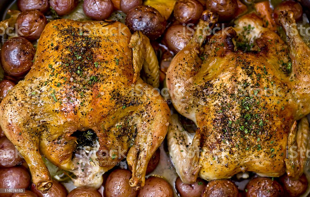 Two Roasted Chickens with Potatoes Large File Detail royalty-free stock photo