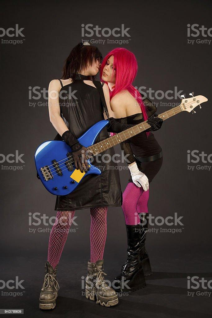 Two rock girls kissing stock photo