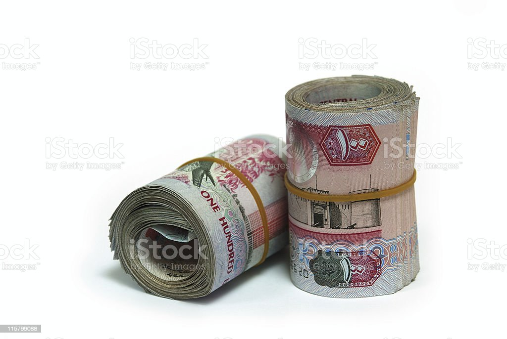 Two rolls of United Arab Emirates one hundred Dirham notes stock photo