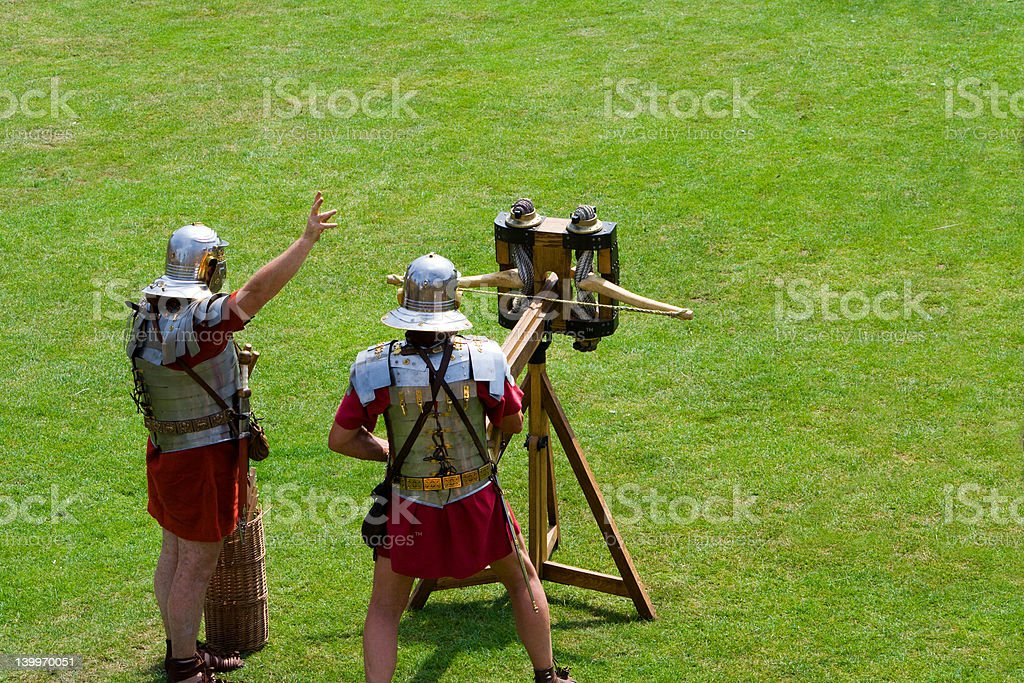 Two Roman Soldiers and a Ballista royalty-free stock photo