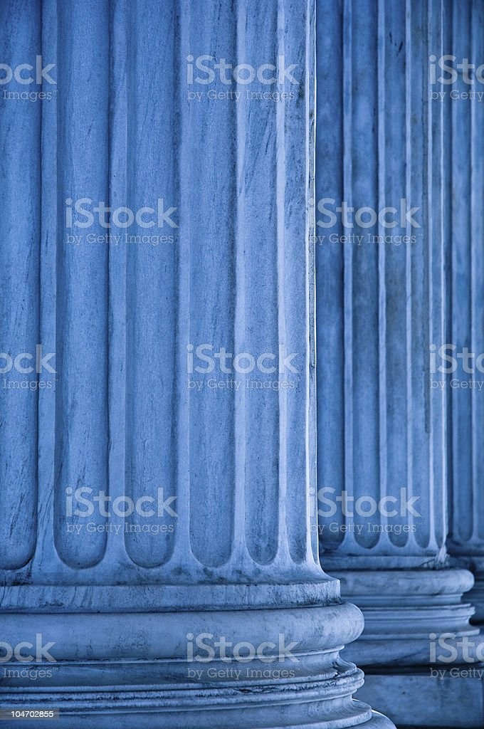 Two roman style tall blue tinted columns stock photo