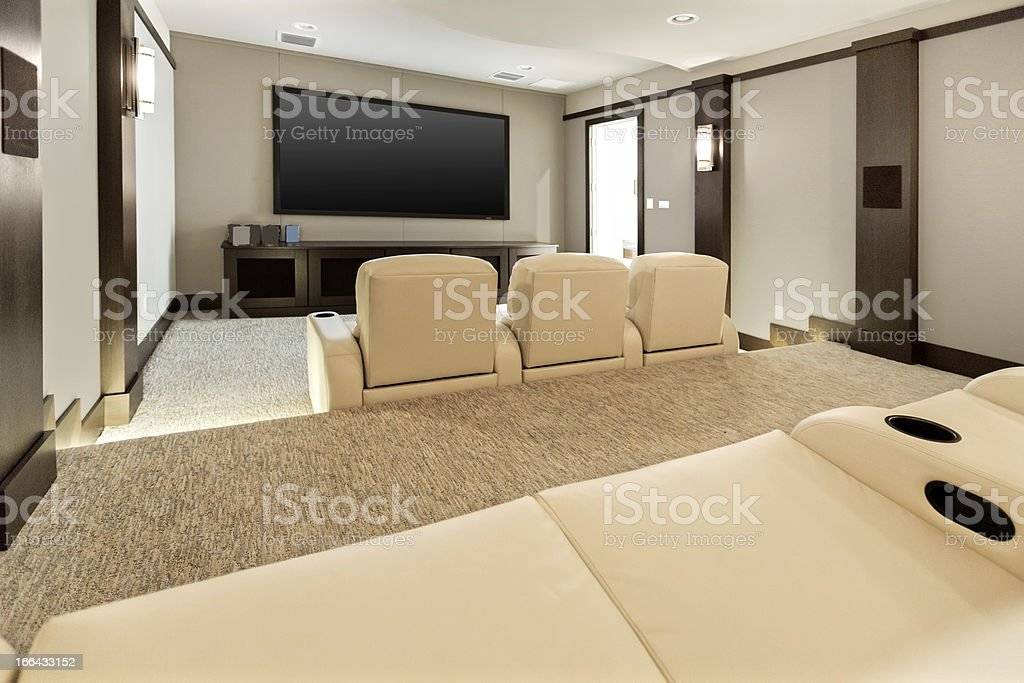 Two room home theatre with large flat screen tv. stock photo
