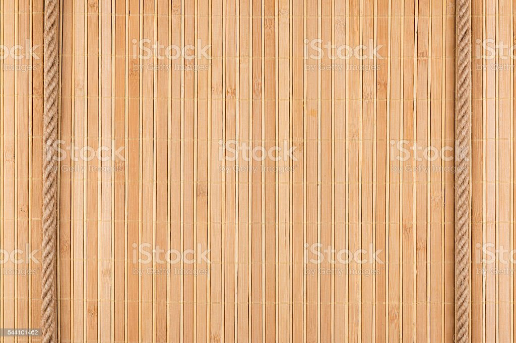 Two ropes lying on a bamboo mat stock photo