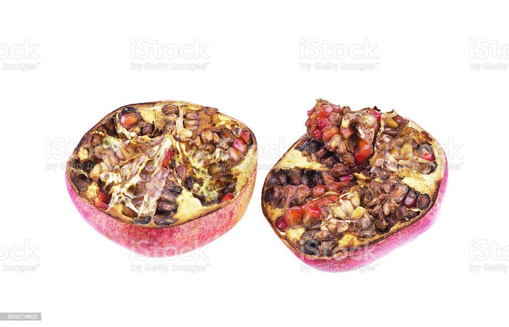 Two rotten pomegranate segments stock photo
