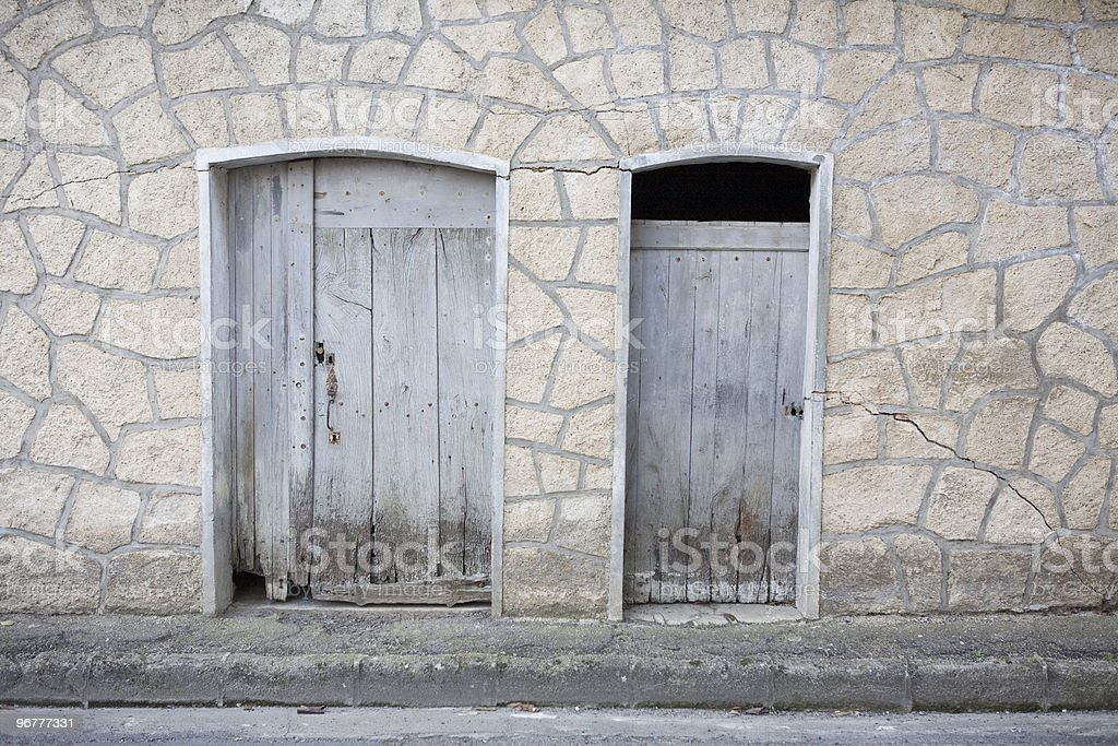 Two rotting doors and wall stock photo