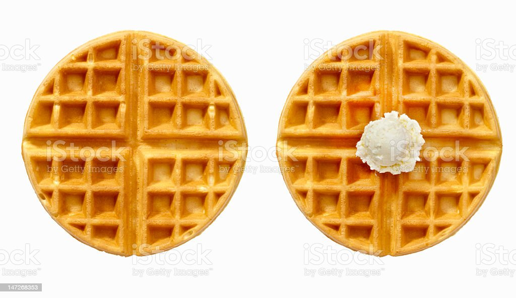 Two round waffles, one with ice cream stock photo
