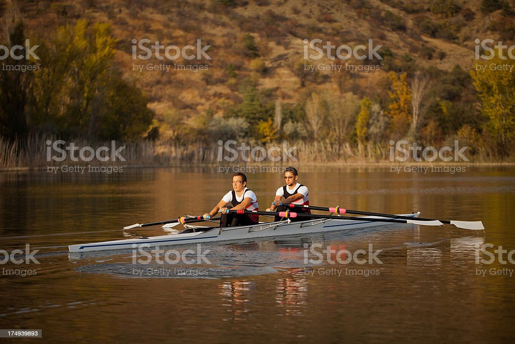 Two rower young men on the boat royalty-free stock photo