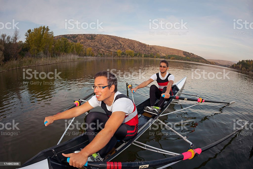 Two rowers young men on the boat royalty-free stock photo