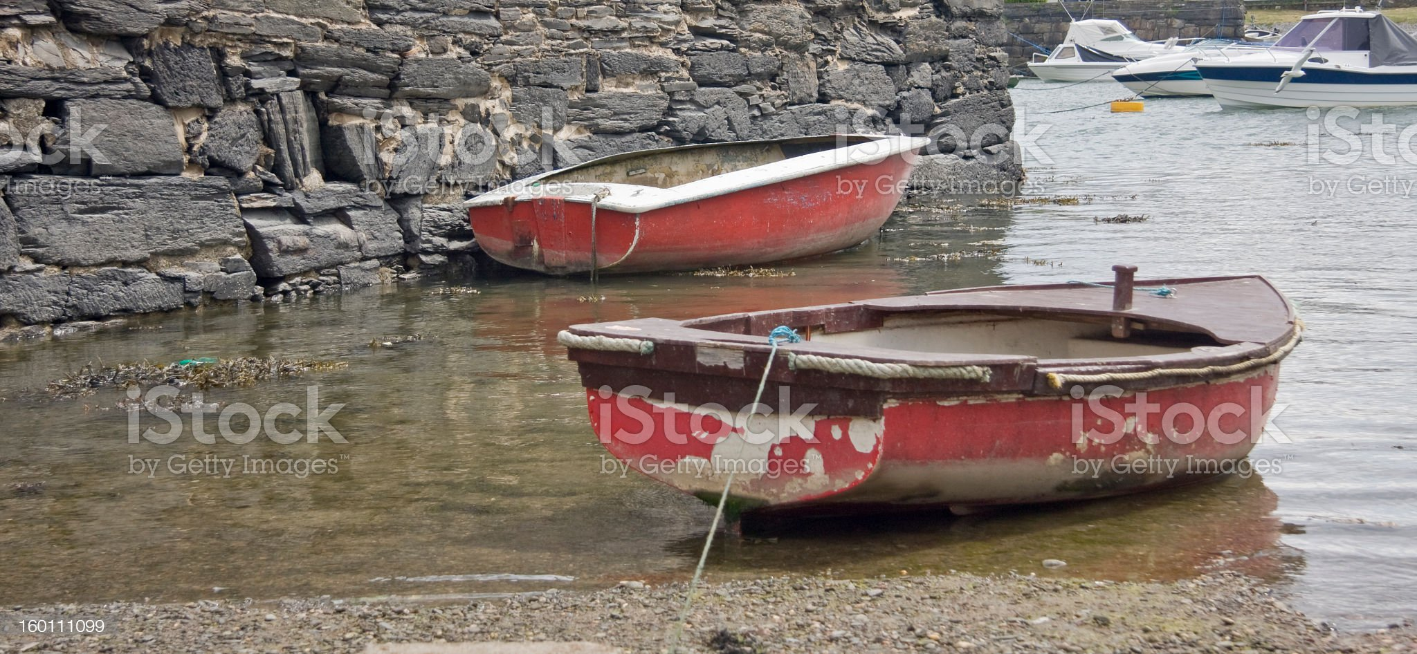 Two rowing boats moored in harbour royalty-free stock photo