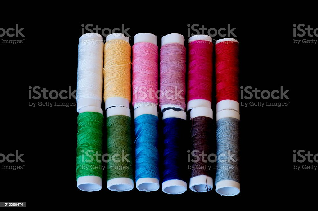 Two rows formed from colourful threads in gradient colours stock photo