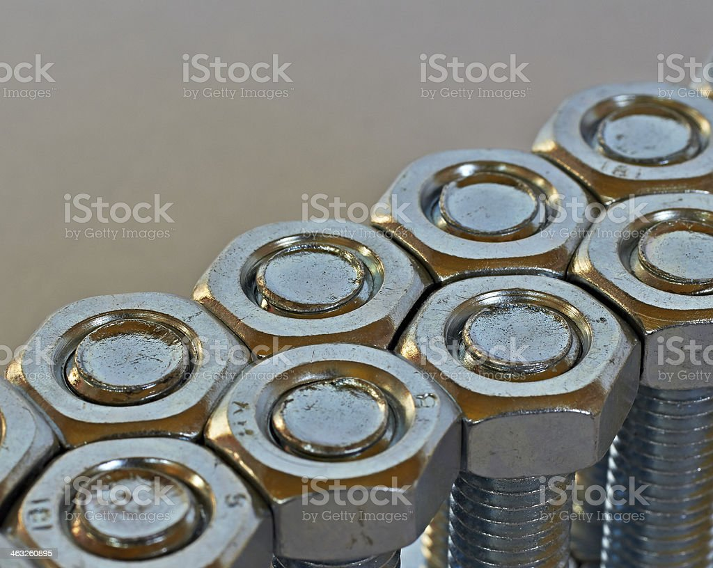 two rows of bolts and nuts royalty-free stock photo