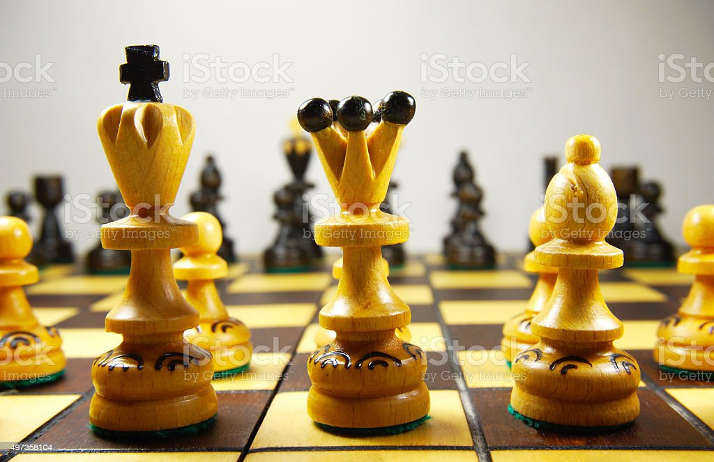 two rows of chess pieces stock photo