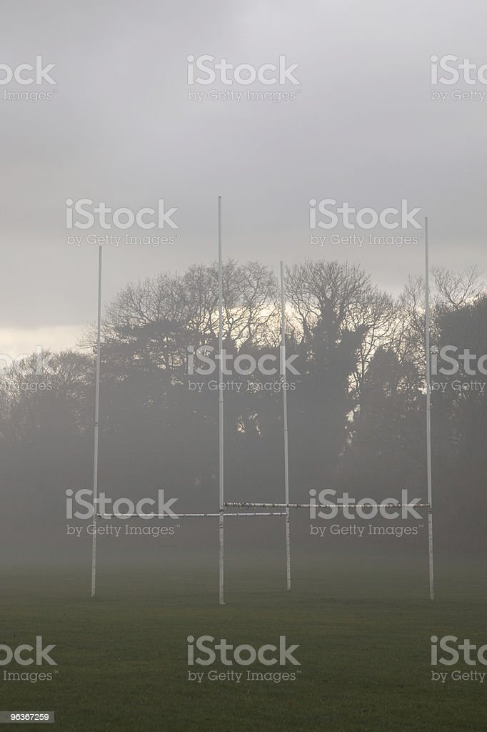 Two rugby posts on a foggy morning stock photo
