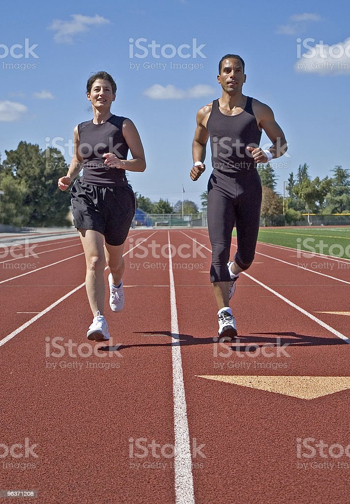 Two Runners Jogging on Race Track royalty-free stock photo