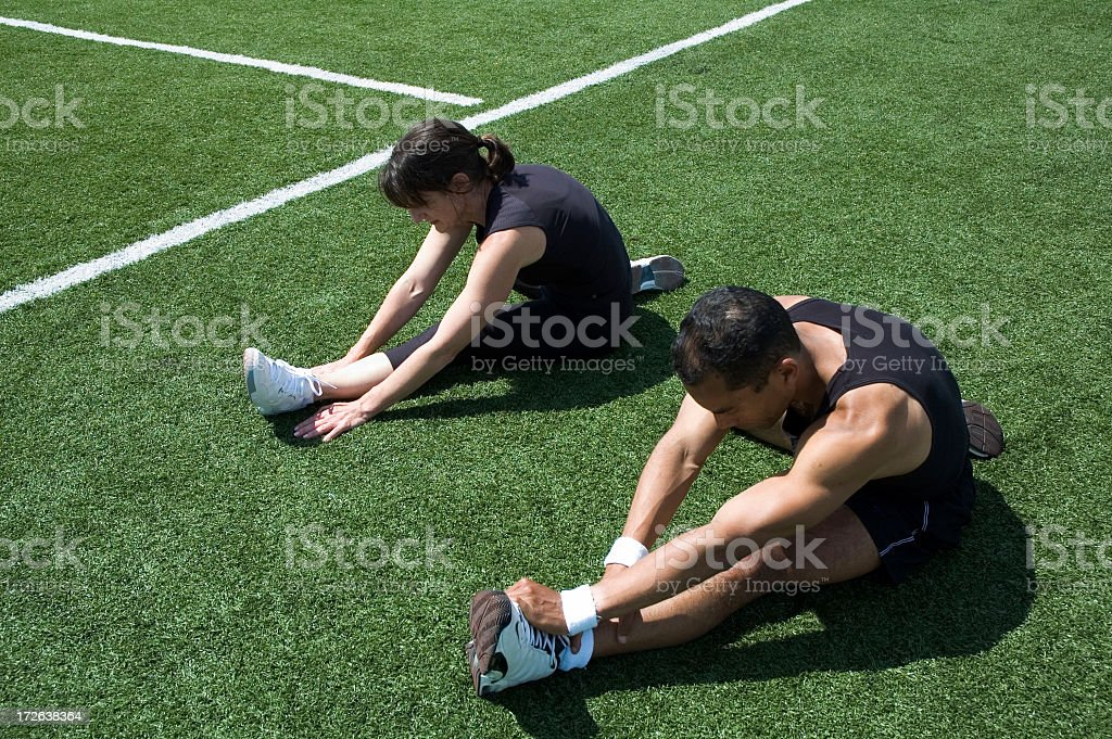 Two Runners stretching stock photo