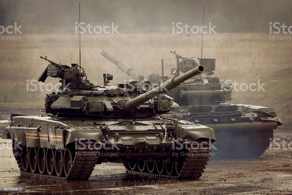 two Russian T-90 tank on military range stock photo