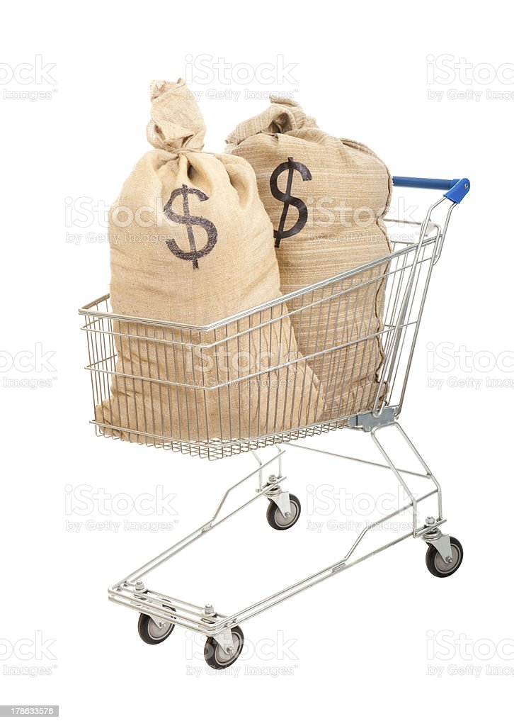 Two sacks full of dollars in shopping cart stock photo