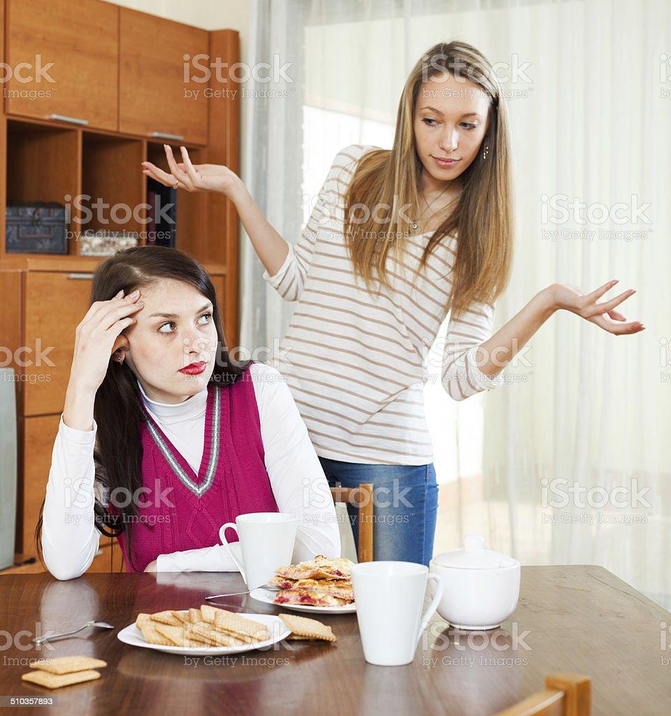 Two sad women having conflict stock photo