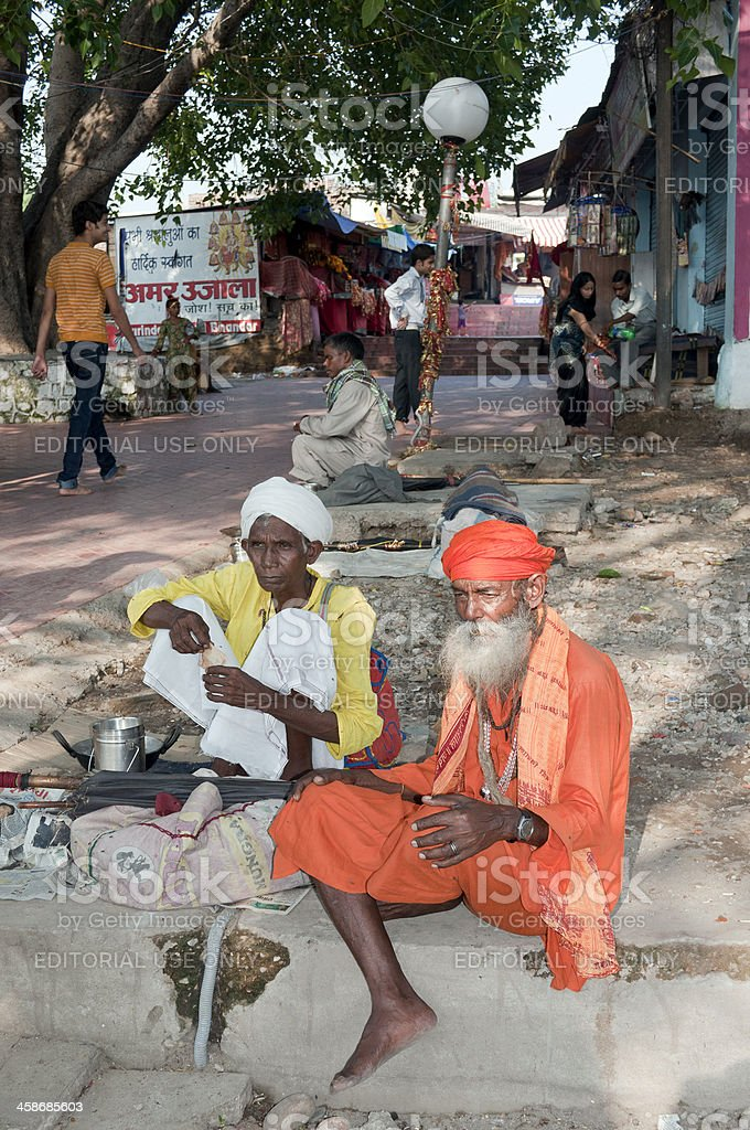 Two Sadhu Sitting in Shade Bahu Fort India royalty-free stock photo