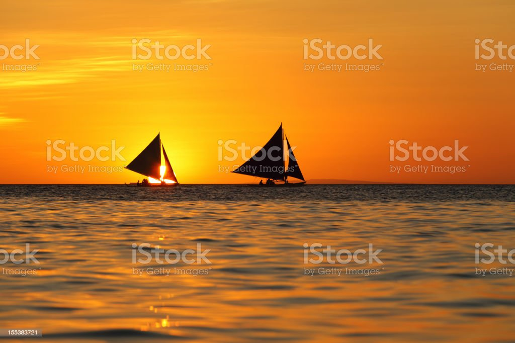 Two sailboats and beautiful sunset royalty-free stock photo